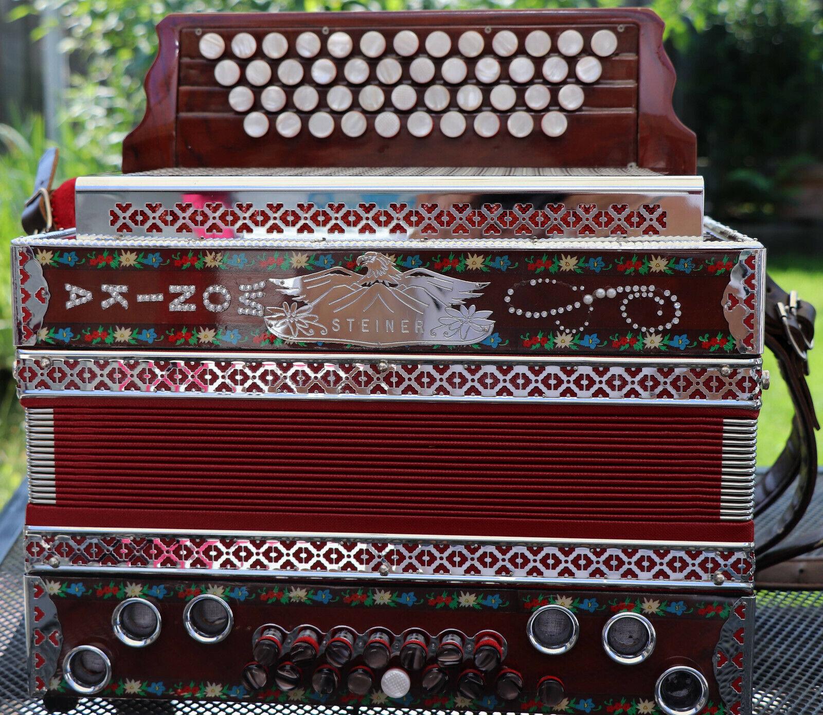 Steirische Harmonika der Firma Steiner, 4reihig G C F B mit Koffer